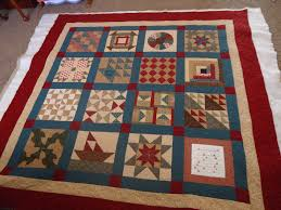 Modern Tradition Quilts: The Underground Railroad Quilts & This quilt top was by M. McReynolds. I really like the way the teal sashing  draws in your eye. She chose longarm feathers for the outer borders and  sashing, ... Adamdwight.com