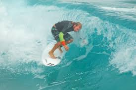 professional surfer peter mendia of west palm beach rides a wavejet surfboard near the lake worth pier mendia says the propulsion system allows him to