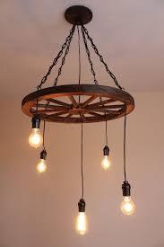 wagon wheel lighting fixtures. vintage industrial wagon wheel chandelier by uevrwndry on etsy more lighting fixtures