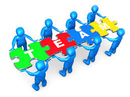 qualities inspiring edchat team of 8 blue people holding up connected pieces to a colorful puzzle that spells out