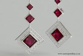 antique style princess cut ruby art deco earrings with milgrain in white gold or platinum