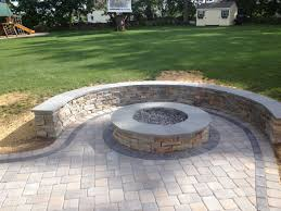 modern collection fire pit on patio pavers round brick stone