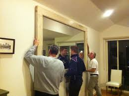 lifting heavy mirror onto french cleats hanging heavy mirror installing large paintings heavy