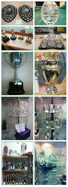 a selection of trophies in pewter wood silver and gl