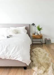 small sheepskin rugs beautiful faux rug in bedroom with basement next to wood floor area alongside
