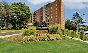 entrance monument at cedar gardens and towers apartments townhomes in windsor mill
