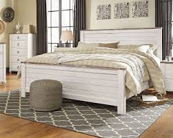 white coastal furniture. White Coastal Bed With Distressed Wood Tan Bedding A Geometric Rug And Pouf On Furniture