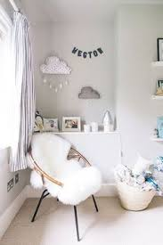 photography by adam crohill photography a modern stylish uni baby nursery with a neutral grey colour scheme with blue and green accents and a grey cot