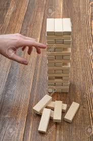Wooden Bricks Game Closeup Hands Of Man Pulls Out Wooden Bricks Removing Blocks 35