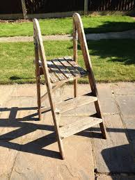 heavy duty old wooden 3 step thread ladder with platform used