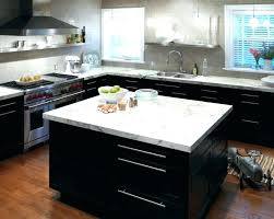 dark wood kitchen cabinets with white countertops black cabinet