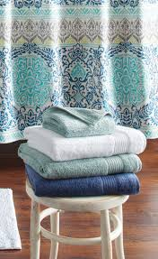 better homes and gardens bath towels. pretty towels in a basket or on shelving for guests. better homes and gardens extra bath
