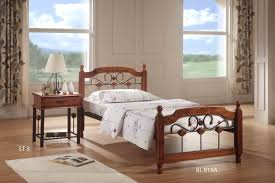 wood bed for charming bedroom bizezz furniture single classic with iron headboard design as well varnished charming bedroom furniture