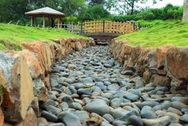 River rock can be used to simulate waterways in your landscape.
