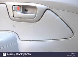inside car door lock beige color close up background texture stock image