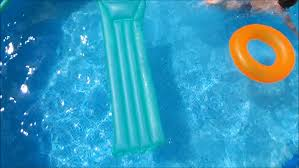 swimming pool beach ball background. Little Boy Swimming In Pool On Orange Inflatable Rubber Ring. - HD Stock Footage Clip Beach Ball Background T