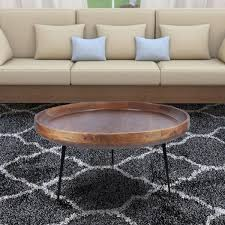 round brown and black coffee table with metal legs