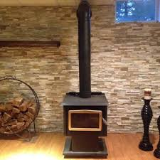 rustic basement with a wood stove