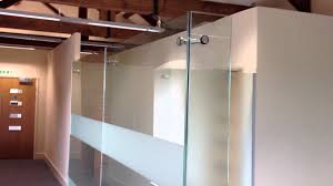 full fit out office furniture installation from aci with frameless glass partitions you