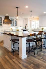 Love The Huge Island/bar.Two Pendant Lights Illuminate A New Kitchen Island  With A Countertop Made From The Wood Of An Old Train Car.