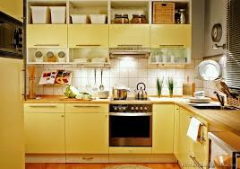 modern yellow kitchen with er toned cabinets butcher block countertops and open shelves