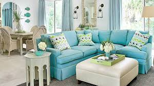 white coastal furniture. Coastal Furniture Ideas For Living Room With Blue L Shape Sofa And Motif Cushions Also White Wooden Sidechair Table