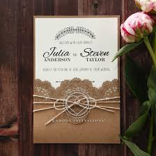 craft paper outer pocket with fl laser cut invite wrapped with twine