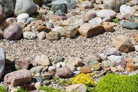 caring for a rock garden bed how to