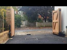 wooden bi folding gates