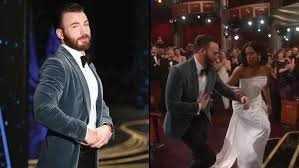 Chris Evans Helping Regina King Up The Stairs At The Oscars Is