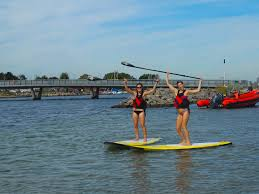 alex and i paddle boarding at amager strand amager bryghus lighting set