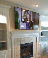 tv over fireplace mounting and installation services charlotte nc interesting ideas design