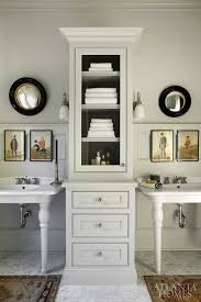 double pedestal sinks with tall cabinet in between for storage