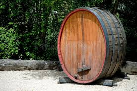 very old large wine barrel oval shaped about six feet tall