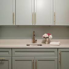 long drawer pulls. Brilliant Drawer Gray Laundry Room Cabinets With Long Brass Pulls In Drawer