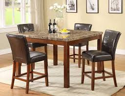 four chairs in dining room. bar height dining table with four chairs in room