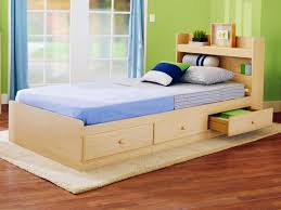 Single Beds For Small Bedrooms Cream Wooden Single Bed With Drawers And Blue Bed Sheet Also