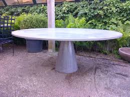 stunning large round outdoor dining table and concrete slice