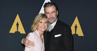 John Travolta and Olivia Newton-John to host