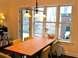 pendant lighting for dining table. triple pendant lighting for dining room lights with small rectangular table and beige backdrop
