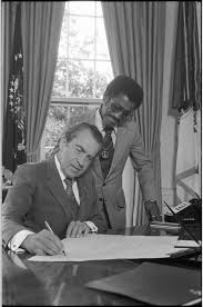 nixon office. President Richard Nixon Signing A Document At His Desk In The Oval Office As Sammy Davis S