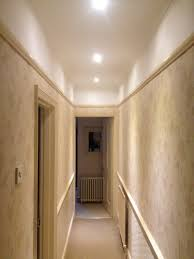 fancy droped ceiling lamps as romantic hallway lighting added neutral wallpaper as modern small space hallway decorating designs