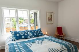 inspired tie dye bedding in bedroom eclectic with indian decor next to railroad tie fence alongside blue bedding and indian windows