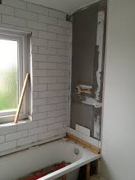 wall tiling around a bath