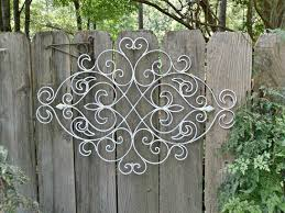 exterior: Gorgeous Fence Decor Which Is Made Of Metal Elements And Painted  In Bright White