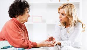 caregiver having a serious talk with her patient