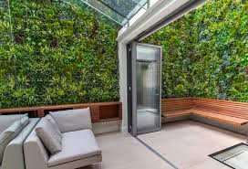vistagreen s artificial living wall system added colour and lush greenery to a small notting hill urban on artificial forest fern green wall foliage with vertical garden green wall design installation ideas by vistagreen
