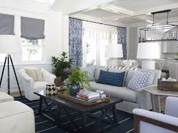 country living room with white walls and blue rug along with black table and white floor