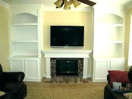 fireplace with bookshelves on each side fireplace with bookshelves fire places beach style on each side