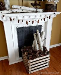 birch log pine cones at the fireplace decorating the fireplace for winter